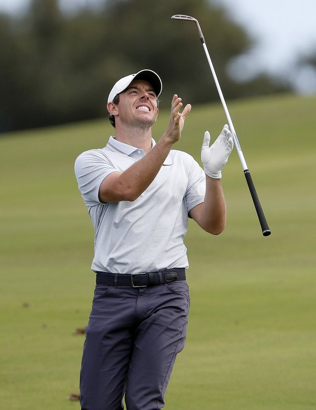 Rory McIlroy tosses his club after his approach shot on the 12th green during the third round of the Tournament of Champions golf event, Saturday, Jan. (AP Photo/Matt York)