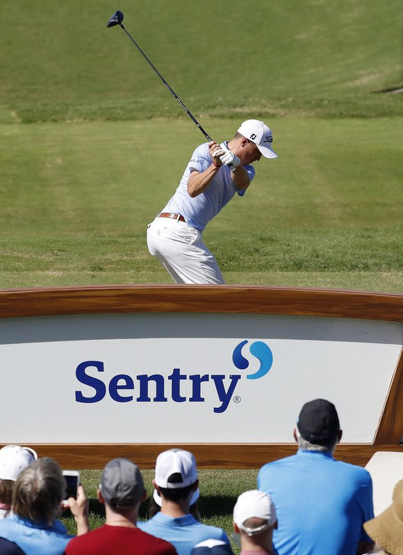 Justin Thomas plays his shot from the first tee during the final round of the Tournament of Champions golf event, Sunday, Jan. (AP Photo/Matt York)
