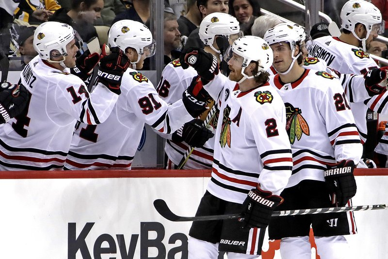 Chicago Blackhawks' Duncan Keith (2) returns to the bench after scoring during the second period of an NHL hockey game against the Pittsburgh Penguins in Pittsburgh, Sunday, Jan. (AP Photo/Gene J. Puskar)