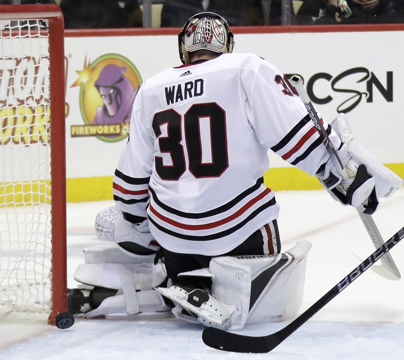 A shot by Pittsburgh Penguins' Derick Brassard gets between the pads of Chicago Blackhawks goaltender Cam Ward (30) for a goal in the second period of an NHL hockey game in Pittsburgh, Sunday, Jan. (AP Photo/Gene J. Puskar)