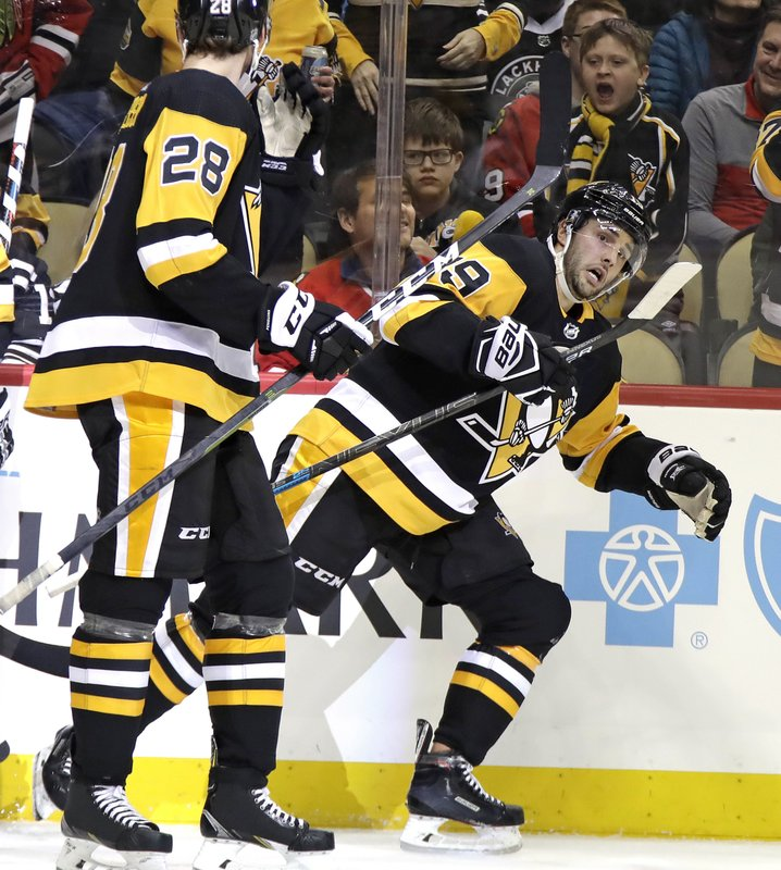 Pittsburgh Penguins' Derick Brassard (19) heads back to his bench after scoring during the second period of an NHL hockey game against the Chicago Blackhawks in Pittsburgh, Sunday, Jan. (AP Photo/Gene J. Puskar)