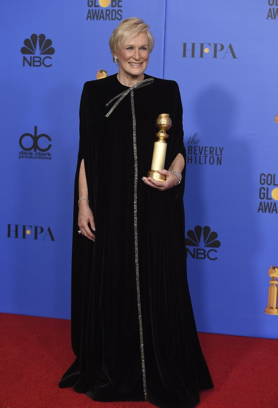 Glenn Close poses in the press room with the award for best performance by an actress in a motion picture, drama for
