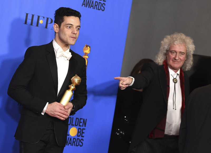 Rami Malek poses in the press room with the award for best performance by an actor in a motion picture, drama for
