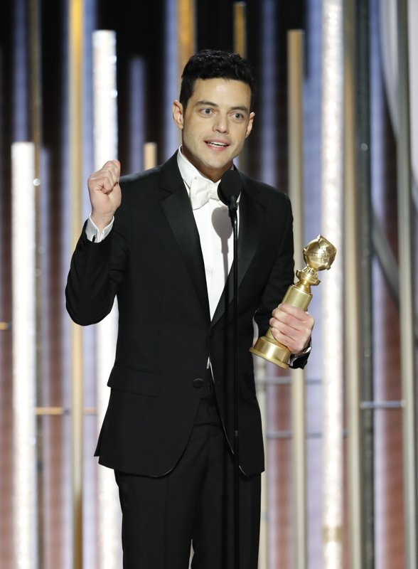 This image released by NBC shows Rami Malek accepting the award for best actor in a motion picture drama for his role as Freddie Mercury in a scene from