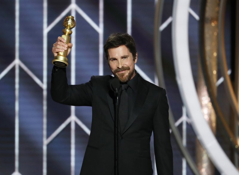 This image released by NBC shows Christian Bale accepting the award for best actor in motion picture musical or comedy for his role in