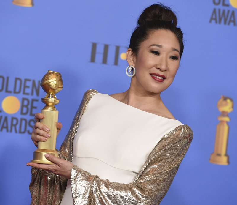 Sandra Oh poses in the press room with the award for best performance by an actress in a television series, drama for