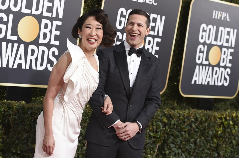 Hosts Sandra Oh, left, and Andy Samberg arrive at the 76th annual Golden Globe Awards at the Beverly Hilton Hotel on Sunday, Jan. (Photo by Jordan Strauss/Invision/AP)