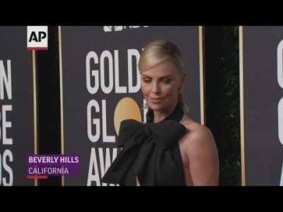 Celebrities including Charlize Theron, Amber Heard, Darren Criss and Rachel Weisz wore black and white ensembles to the Golden Globes. (Jan. 6)