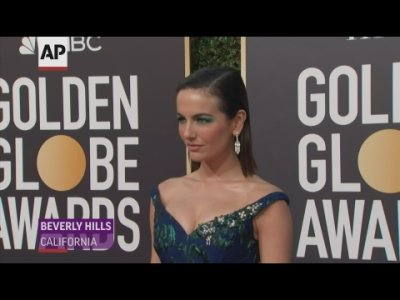 At the Golden Globes, stars took to the carpet with bold palettes and sleek hair, from Camille Belle's teal eyeshadow to Thandie Newton's big-bodied curls. (Jan. 7)