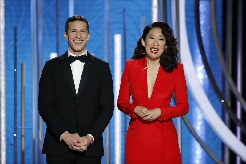 This image released by NBC shows hosts Andy Samberg, left, and Sandra Oh at the 76th Annual Golden Globe Awards at the Beverly Hilton Hotel on Sunday, Jan. (Paul Drinkwater/NBC via AP)