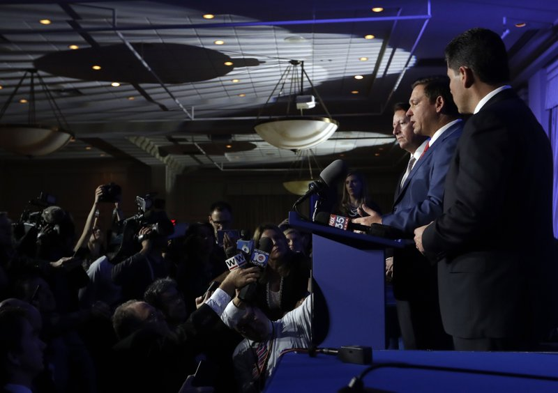 Florida Governor-elect Ron DeSantis, center, speaks during a news conference following a luncheon, Monday, Jan. (AP Photo/Lynne Sladky)