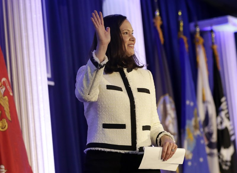 Florida Attorney General-elect Ashley Moody waves after speaking during a military and law enforcement appreciation event, Monday, Jan. (AP Photo/Lynne Sladky)