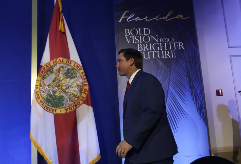 Florida Governor-elect Ron DeSantis arrives for a news conference following a luncheon, Monday, Jan. 7, 2019, in Tallahassee, Fla. (AP Photo/Lynne Sladky)
