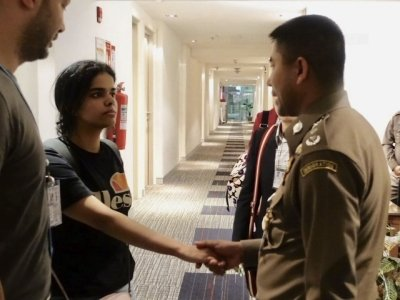 An 18-year-old Saudi woman who was stopped in Bangkok as she was trying to travel to Australia for asylum to escape alleged abuse by her family on Monday left her airport hotel room for temporary admission into Thailand. (Jan. 7)