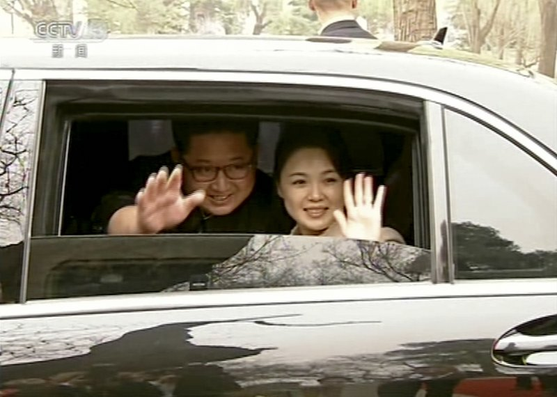 FILE - In this file image taken from video footage run on March 28, 2018, by China's CCTV via AP Video, North Korean leader Kim Jong Un and his wife Ri Sol Ju wave from a car as they bid farewell to Chinese counterpart Xi Jinping and his wife Peng Liyuan in Beijing. (CCTV via AP Video, File)