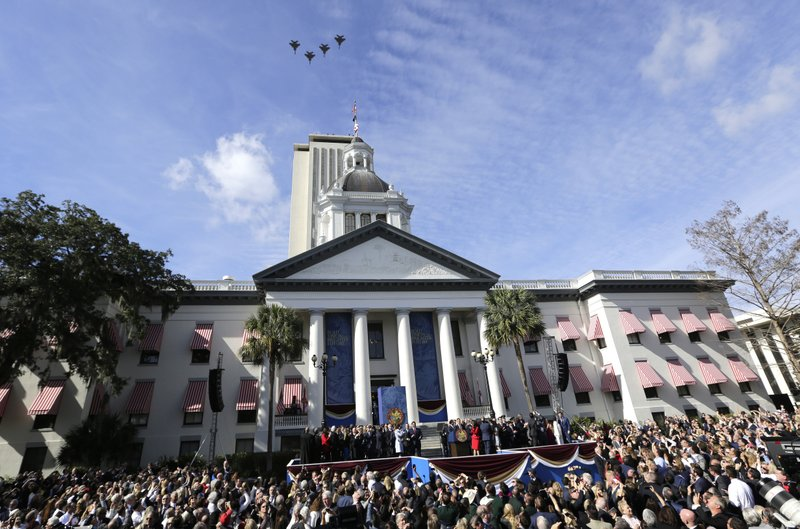 Jets fly over the Old Capitol building during an inauguration ceremony where Rick DeSantis was sworn in as Florida Governor, Tuesday, Jan. (AP Photo/Lynne Sladky)