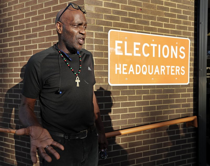 Former felon Robert Eckerd talks with reporters after registering to vote at the Supervisor of Elections office Tuesday, Jan. (AP Photo/John Raoux)