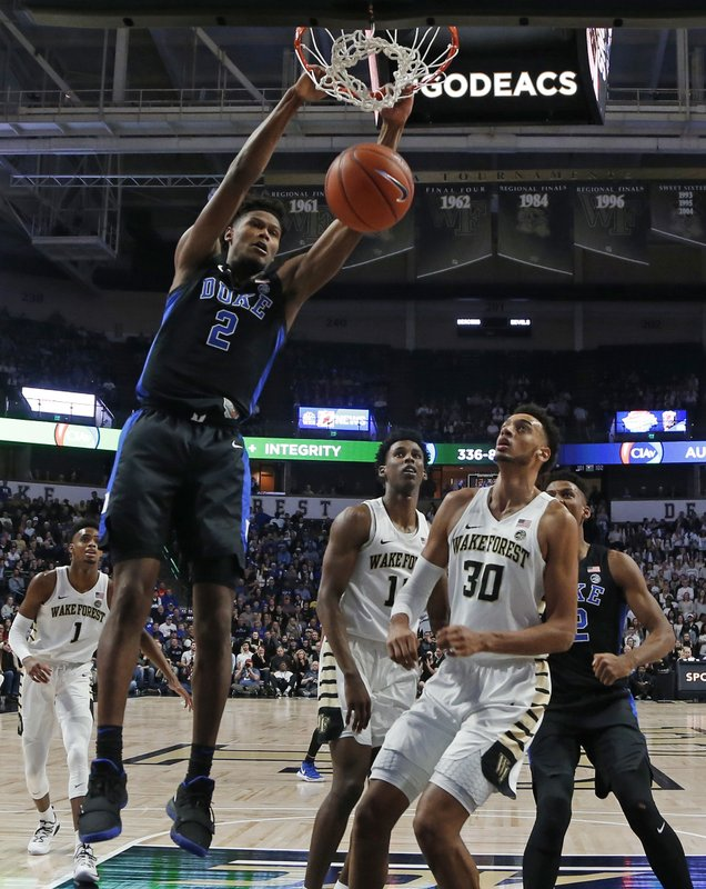 Duke's Cam Reddish (2) dunks past Wake Forest's Olivier Sarr (30) during the first half of an NCAA college basketball game in Winston-Salem, N. (AP Photo/Chuck Burton)
