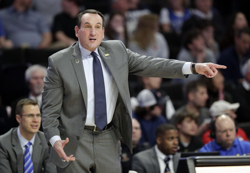 Duke coach Mike Krzyzewski directs his team against Wake Forest during the first half of an NCAA college basketball game in Winston-Salem, N. (AP Photo/Chuck Burton)