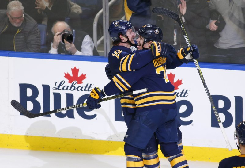 Buffalo Sabres Jake McCabe (19) and Evan Rodrigues (71) celebrate a goal during the second period of an NHL hockey game against the New Jersey Devils, Tuesday, Jan. (AP Photo/Jeffrey T. Barnes)