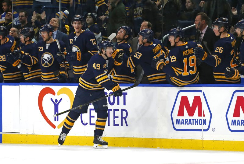 Buffalo Sabres forward C.J. Smith (49) celebrates his first career goal during the second period of an NHL hockey game against the New Jersey Devils, Tuesday, Jan. (AP Photo/Jeffrey T. Barnes)