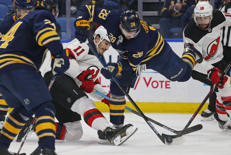 Buffalo Sabres forward Zemgus Girgensons (28) and New Jersey Devils forward Brian Boyle (11) battle for the puck during the second period of an NHL hockey game, Tuesday, Jan. (AP Photo/Jeffrey T. Barnes)