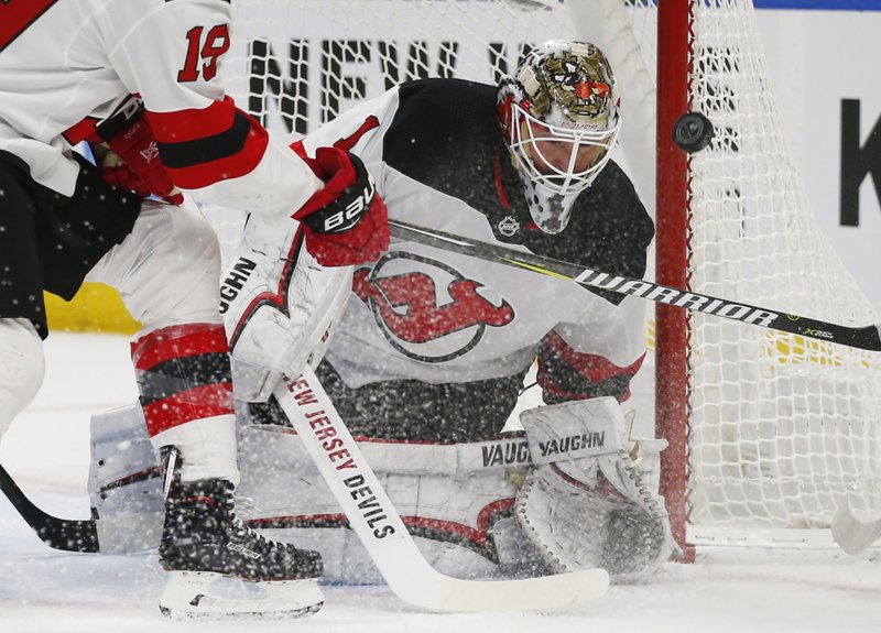 New Jersey Devils goalie Keith Kinkaid (1) makes a save during the first period of an NHL hockey game against the Buffalo Sabres, Tuesday, Jan. (AP Photo/Jeffrey T. Barnes)