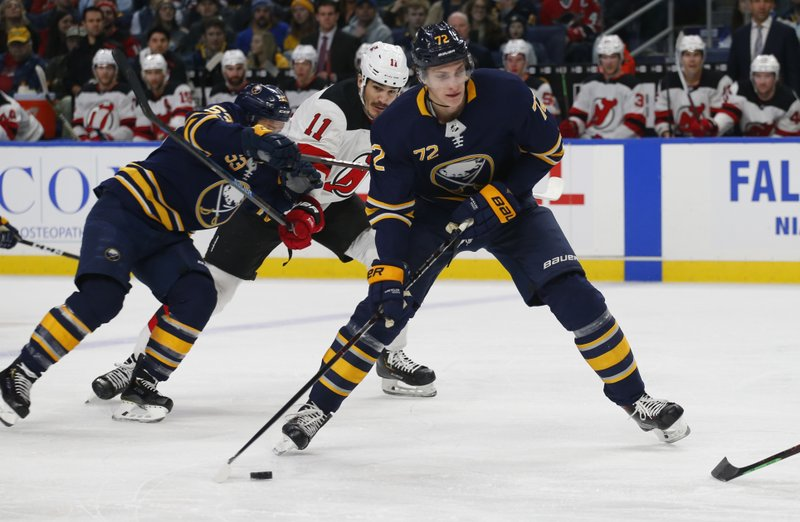 Buffalo Sabres forward Tage Thompson (72) controls the puck during the first period of an NHL hockey game against the New Jersey Devils, Tuesday, Jan. (AP Photo/Jeffrey T. Barnes)