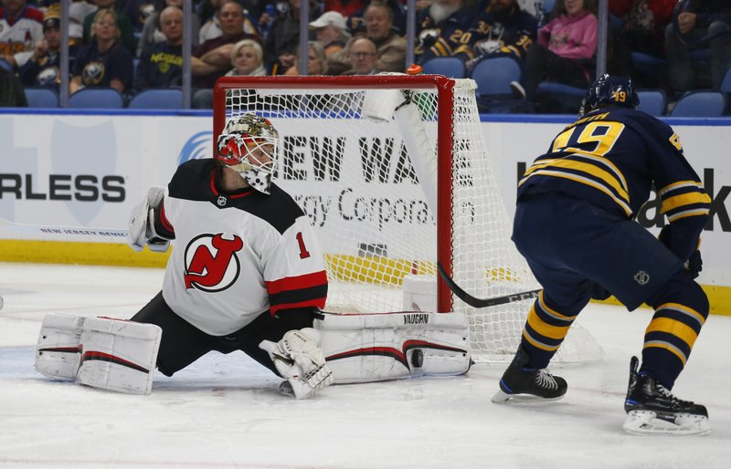 Buffalo Sabres forward C.J. Smith (49) is stopped by New Jersey Devils goalie Keith Kinkaid (1) during the first period of an NHL hockey game, Tuesday, Jan. (AP Photo/Jeffrey T. Barnes)