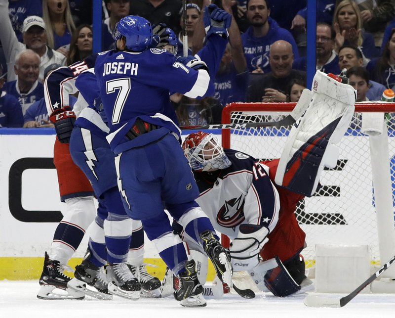 Tampa Bay Lightning right wing Mathieu Joseph (7) scores past Columbus Blue Jackets goaltender Sergei Bobrovsky (72) during the first period of an NHL hockey game Tuesday, Jan. (AP Photo/Chris O'Meara)
