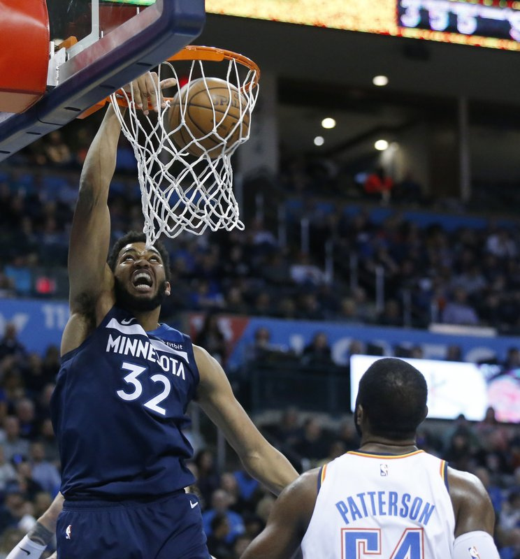 Minnesota Timberwolves center Karl-Anthony Towns (32) dunks in front of Oklahoma City Thunder forward Patrick Patterson (54) in the first half of an NBA basketball game in Oklahoma City, Tuesday, Jan. (AP Photo/Sue Ogrocki)