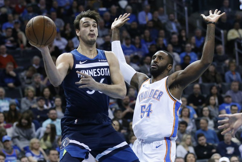 Minnesota Timberwolves forward Dario Saric (36) passes in front of Oklahoma City Thunder forward Patrick Patterson (54) in the first half of an NBA basketball game in Oklahoma City, Tuesday, Jan. (AP Photo/Sue Ogrocki)