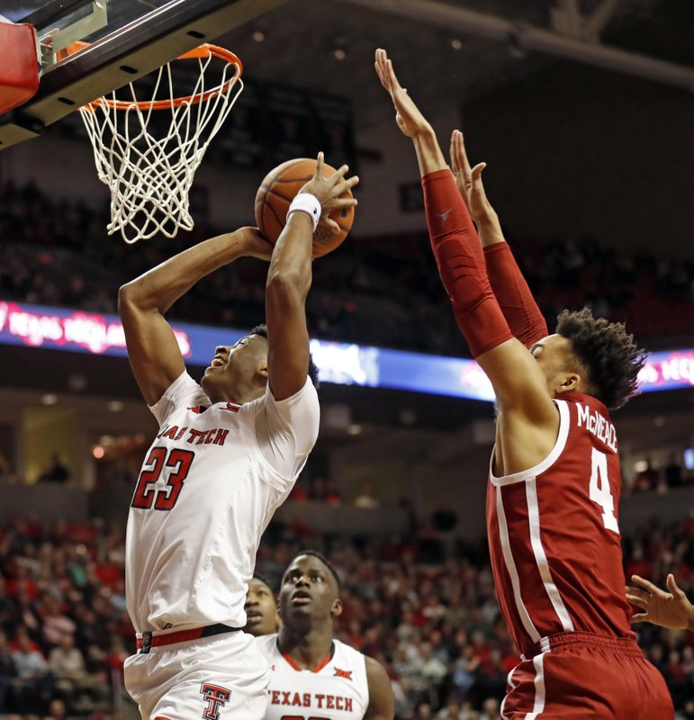 Texas Tech's Jarrett Culver (23) shoots in front of Oklahoma's Jamuni McNeace (4) during the first half of an NCAA college basketball game Tuesday, Jan. (AP Photo/Brad Tollefson)