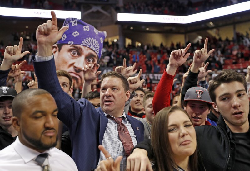 Texas Tech coach Chris Beard celebrates on the court with fans after the team's NCAA college basketball game against Oklahoma, Tuesday, Jan. (AP Photo/Brad Tollefson)