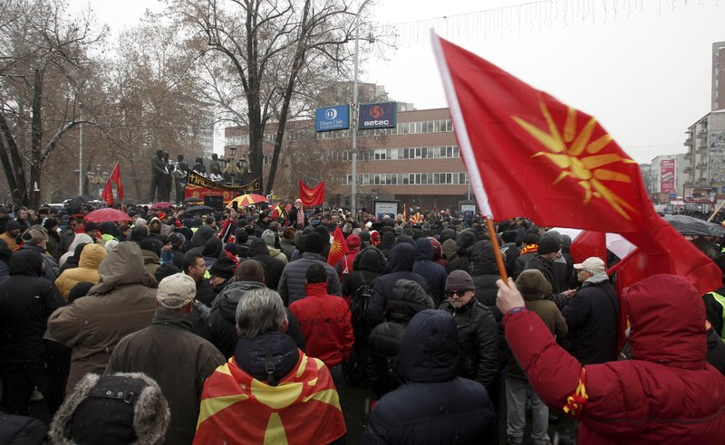 Opponents to the change of the country's constitutional name protest outside the parliament building prior to a session of the Macedonian Parliament in the capital Skopje, Wednesday, Jan. (AP Photo/Boris Grdanoski)