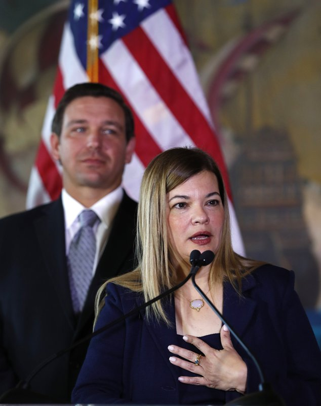 Barbara Lagoa, Governor Ron DeSantis' pick for the Florida Supreme Court, gestures as she speaks after being introduced, Wednesday, Jan. (AP Photo/Wilfredo Lee)