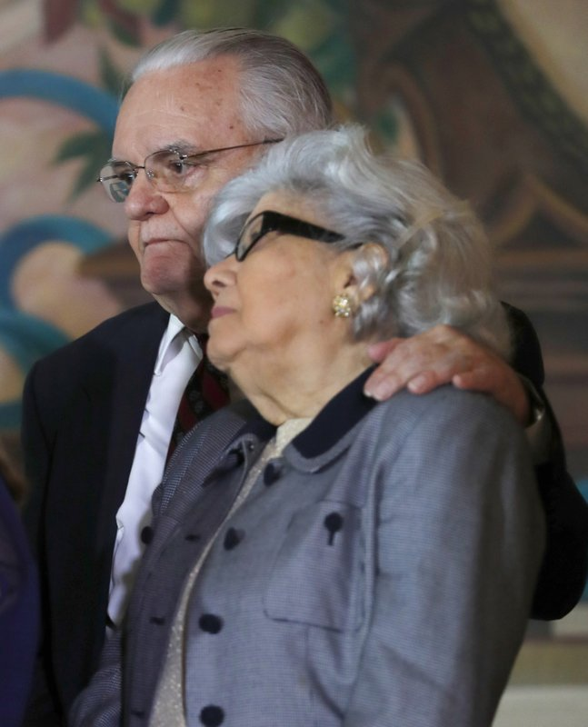 Antonio and Araceli Lagoa, the parents of Barbara Lagoa, Governor Ron DeSantis' pick for the Florida Supreme Court, look on as she speaks after being introduced, Wednesday, Jan. (AP Photo/Wilfredo Lee)
