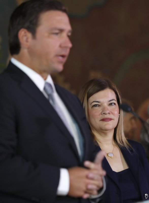 Barbara Lagoa, right, looks on as Governor Ron DeSantis introduces her as his pick for the Florida Supreme Court, Wednesday, Jan. (AP Photo/Wilfredo Lee)