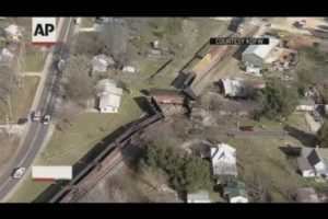 Train derailment sends freight cars into back yards
