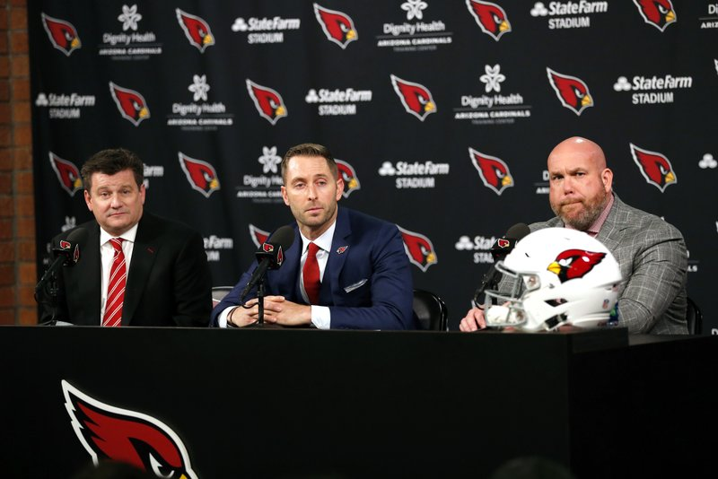 The Arizona Cardinals introduce their new head coach Kliff Kingsbury, middle, flanked by owner Michael Bidwell, left, and general manager Steve Keim, Wednesday, Jan. (AP Photo/Rick Scuteri)