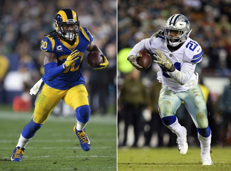 FILE - At left, in a Dec. 16, 2018, file photo, Los Angeles Rams running back Todd Gurley sprints in an NFL football game against the Philadelphia Eagles, in Los Angeles. (21) runs against the Philadelphia Eagles during an NFL football game, in Philadelphia. Gurley is a big football fan, and Elliott is one of his favorite players. The good feelings are mutual heading into the Cowboys' playoff visit to the Rams and a showdown between the NFL's two premiere running backs. (AP Photo/File)