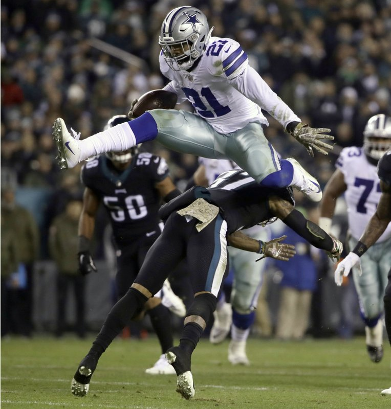 FILE - In this Nov. 11, 2018, file photo, Dallas Cowboys running back Ezekiel Elliott (21) hurdles over Philadelphia Eagles defensive back Tre Sullivan (37) during the first half of an NFL football game, in Philadelphia. (AP Photo/Matt Rourke, File)