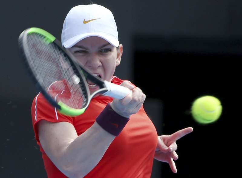 Simona Halep of Romania hits a forehand to Ash Barty of Australia during their women's singles match at the Sydney International tennis tournament in Sydney, Wednesday, Jan. (AP Photo/Rick Rycroft)