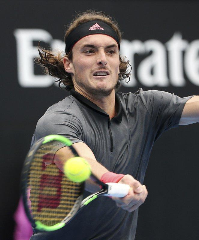 Stefanos Tsitsipas of Greece hits a forehand to Andreas Seppi of Italy during their men's singles match at the Sydney International tennis tournament in Sydney, Thursday, Jan. (AP Photo/Rick Rycroft)
