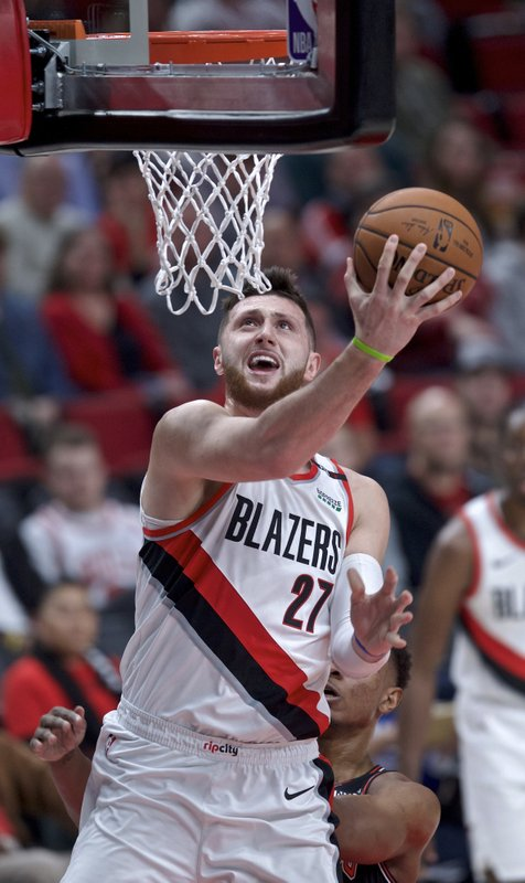 Portland Trail Blazers center Jusuf Nurkic scores during the first half of the team's NBA basketball game against the Chicago Bulls in Portland, Ore. (AP Photo/Craig Mitchelldyer)