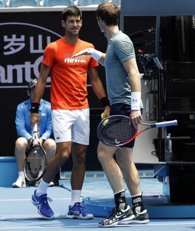 Britain's Andy Murray, right, gestures to Serbia's Novak Djokovic during a practice match on Margaret Court Arena ahead of the Australian Open tennis championships IN Melbourne, Australia, Thursday, Jan. (AP Photo/Mark Baker)