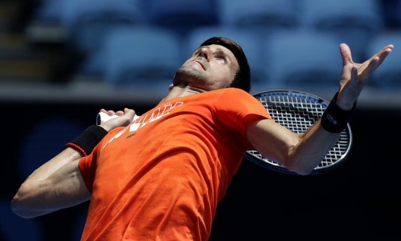 Serbia's Novak Djokovic serves to Britain's Andy Murray during a practice match on Margaret Court Arena ahead of the Australian Open tennis championships in Melbourne, Australia, Thursday, Jan. (AP Photo/Mark Baker)