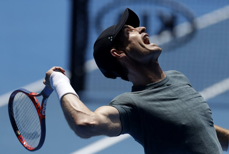 Britain's Andy Murray serves to Serbia's Novak Djokovic during a practice match on Margaret Court Arena ahead of the Australian Open tennis championships IN Melbourne, Australia, Thursday, Jan. (AP Photo/Mark Baker)