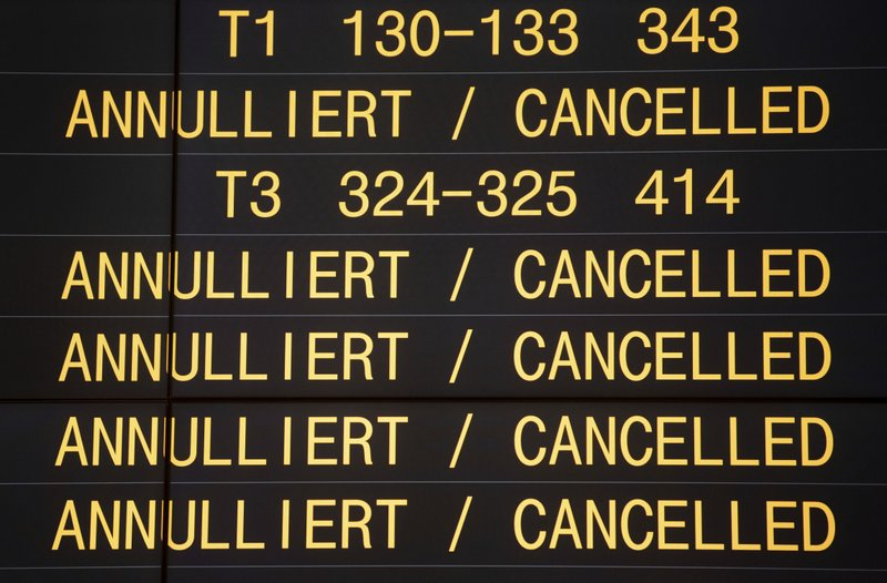 A screen show cancelled flights at the airport in Stuttgart, southern Germany, Thursday, Jan. 10, 2019 when the strike of security staff at three German airports caused severe disruption to flights. (Marijan Murat/dpa via AP)