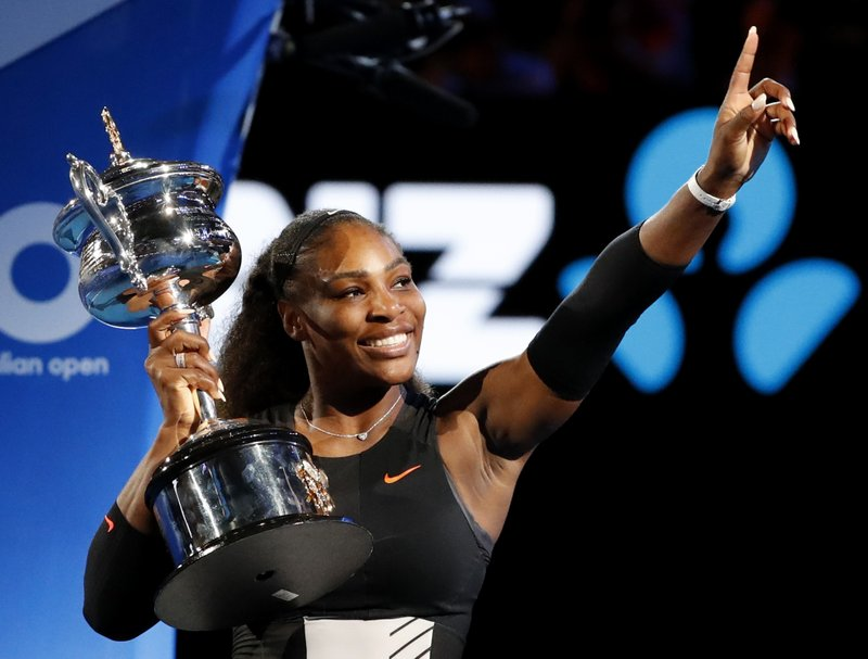 FILE - In this Jan. 28, 2017, file photo, United States' Serena Williams holds her trophy after defeating her sister Venus during the women's singles final at the Australian Open tennis championships in Melbourne, Australia. (AP Photo/Dita Alangkara, File)